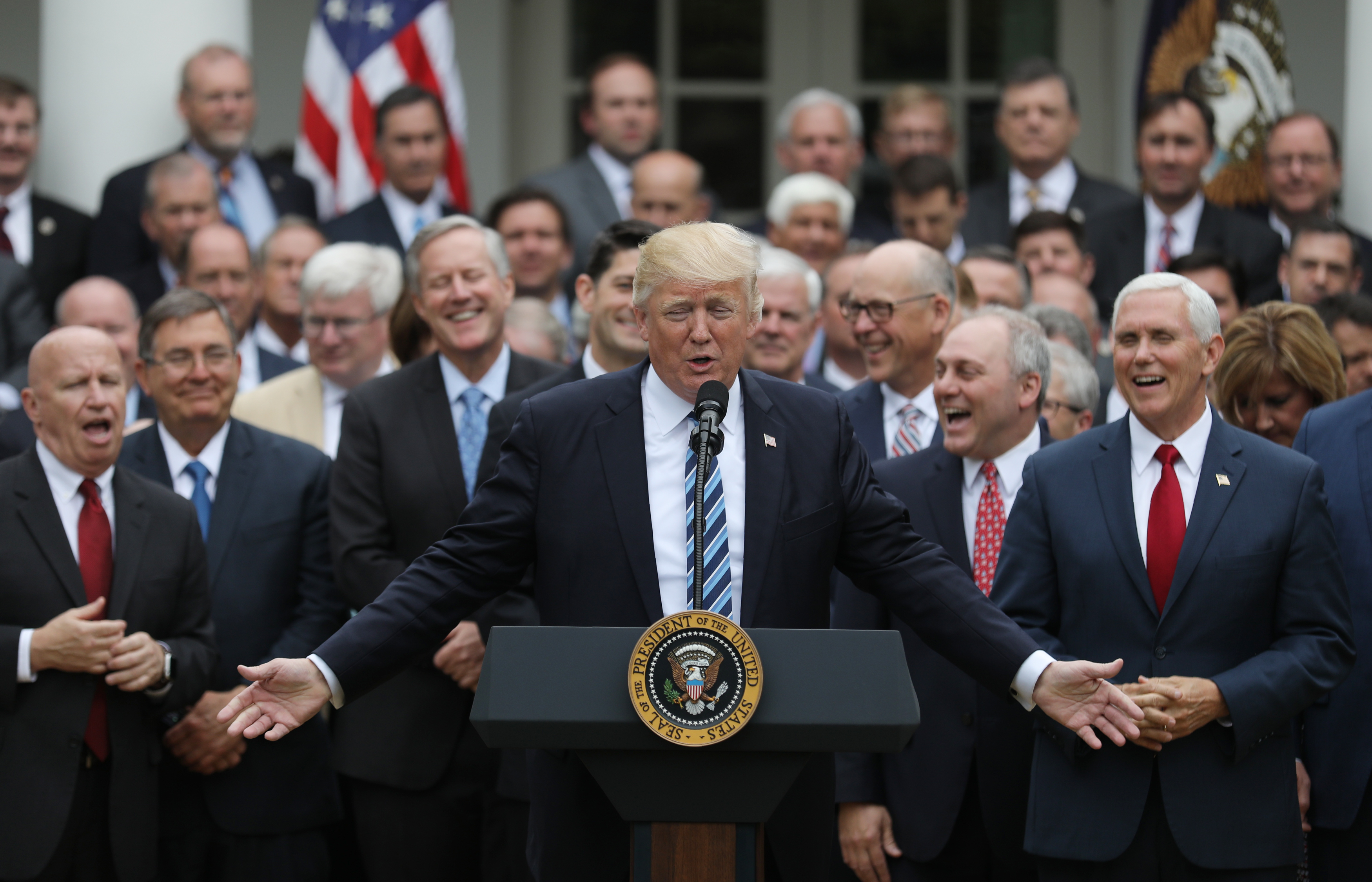 President Donald Trump (C) gathers with Vice President Mike Pence (R) and Congressional Republicans in the Rose Garden of the White House after the House of Representatives approved the American Healthcare Act, to repeal major parts of Obamacare and replace it with the Republican healthcare plan, May 4, 2017.