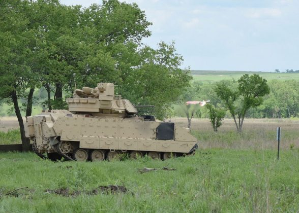 U.S. Army Soldiers, assigned to 1st Armored Brigade Combat Team, 1st Infantry Division, fire a TOW missile from a Bradley Fighting Vehicle during training at Fort Riley, Kansas, May 18, 2016. U.S. Army photo by Capt. Jonathan Camire