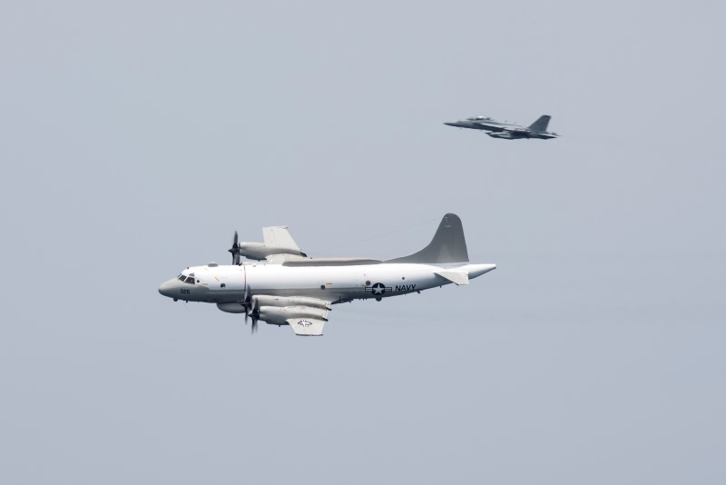 FILE PHOTO: A U.S. Navy EP-3E Aries signals reconnaissance aircraft, escorted by an EA-18G Growler electronic warfare aircraft, performs a flyby over aircraft carrier USS Harry S. Truman in the Arabian Gulf April 24, 2016. U.S. Navy/Mass Communication Specialist 3rd Class Bobby J Siens/Handout/File Photo via REUTERS
