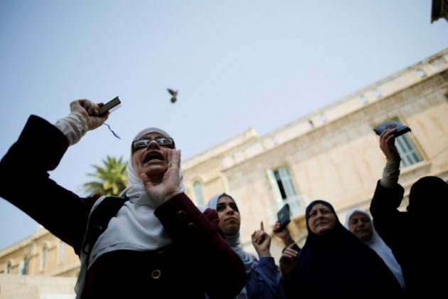Palestinian women shout slogans after a prayer outside the compound known to Muslims as Noble Sanctuary and to Jews as Temple Mount, in Jerusalem's Old City July 27, 2017. REUTERS/Amir Cohen
