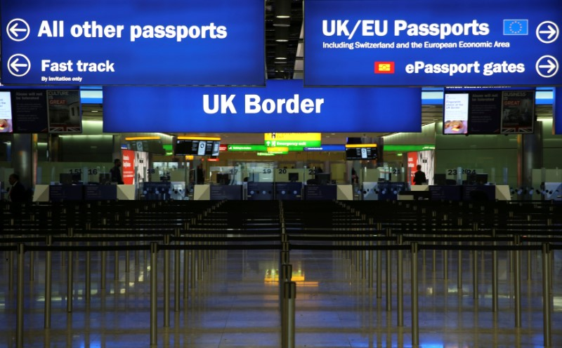 FILE PHOTO: UK Border control is seen in Terminal 2 at Heathrow Airport in London June 4, 2014. REUTERS/Neil Hall/File Photo