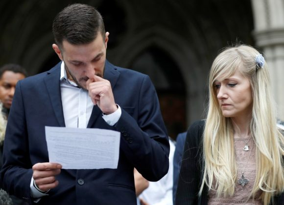 Charlie Gard's parents Connie Yates and Chris Gard read a statement at the High Court after a hearing on their baby's future, in London. REUTERS/Peter Nicholls