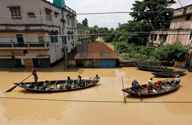 People use boats as they try to move to safer places along a flooded street in West Midnapore district, in West Bengal. REUTERS/Rupak De Chowdhuri