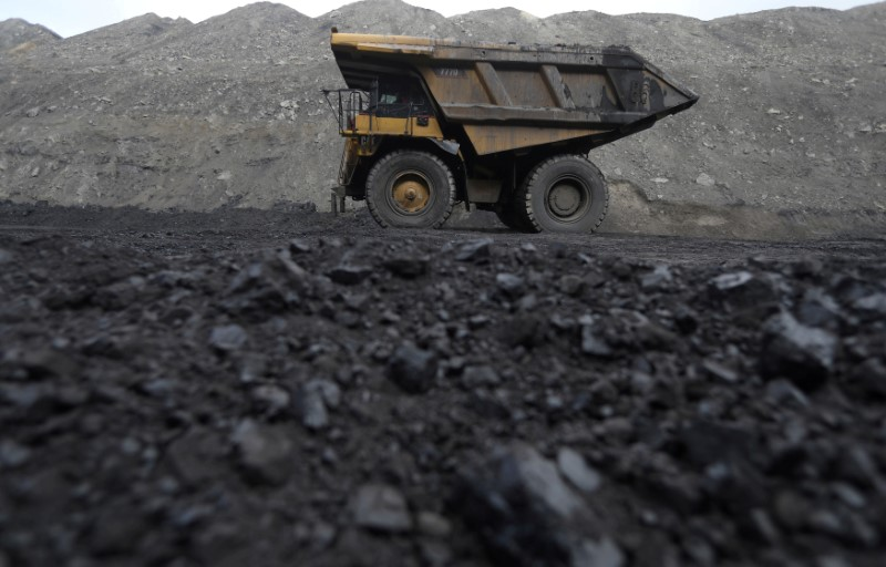 FILE PHOTO: Dump trucks haul coal and sediment at the Black Butte coal mine outside Rock Springs, Wyoming, United States, April 4, 2017. REUTERS/Jim Urquhart/File Photo