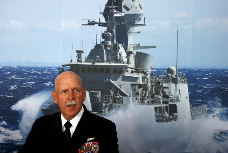 FILE PHOTO: Commander of the U.S. Pacific Fleet Admiral Scott Swift sits in front of a large poster of an Australian Navy frigate as he speaks during a media conference at the 2015 Pacific International Maratime Exposition in Sydney, Australia, October 6, 2015. To match Special Report USA-TRUMP/CARRIERS REUTERS/David Gray/File Photo