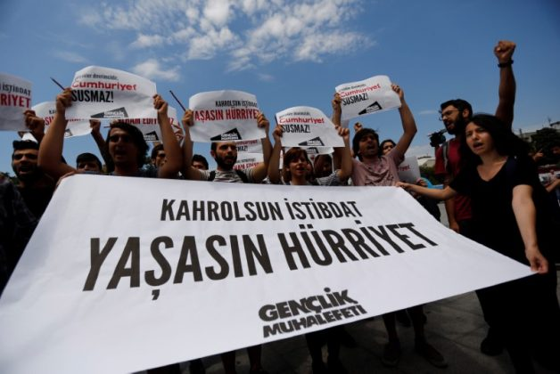 "Press freedom activists shout slogans during a demonstration in solidarity with the jailed members of the opposition newspaper Cumhuriyet outside a courthouse, in Istanbul, Turkey, July 28, 2017. The banner reads: ""To hell with despotism. Long live freedom"".REUTERS/Murad Sezer"