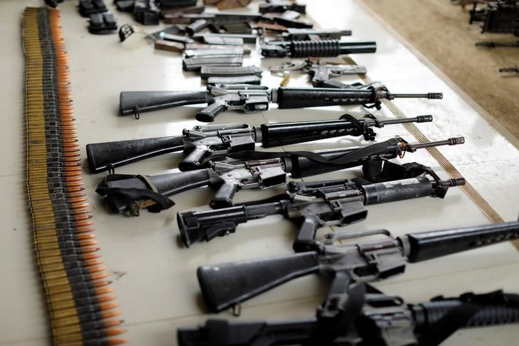 Combat seized weapons are display by Philippines army during a news conference, as government troops continue their assault against insurgents from the Maute group in Marawi city, Philippines July 4, 2017. REUTERS/Jorge Silva