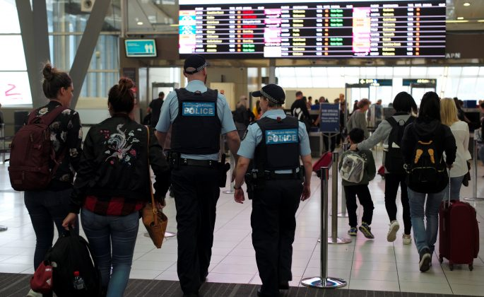 Australia Federal Police officers patrol the security lines at Sydney's Domestic Airport in Australia, July 31, 2017, following weekend raids related to a plot against Australia's aviation sector.