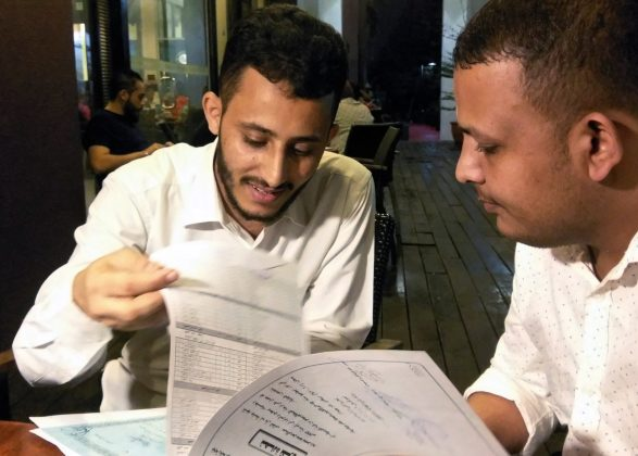 Yemeni Rafek Ahmed Mohammed Al-Sanani (R), 22, and Abdel Rahman Zaid, 26 look through documents as they speak with Reuters in Serdang, on the outskirts of Kuala Lumpur, Malaysia July 20, 2017.