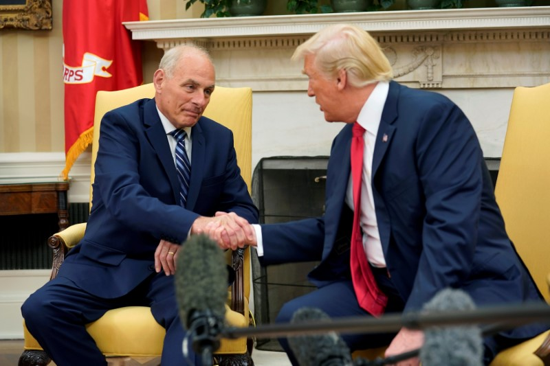 U.S. President Donald Trump shakes hands with John Kelly after he was sworn in as White House Chief of Staff in the Oval Office of the White House in Washington, U.S., July 31, 2017.