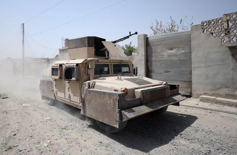 A military vehicle from Syrian Democratic Force is seen in Raqqa city. REUTERS/Rodi Said