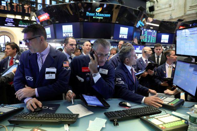 Traders work on the floor of the New York Stock Exchange (NYSE) in New York, U.S., July 19, 2017. REUTERS/Brendan McDermid