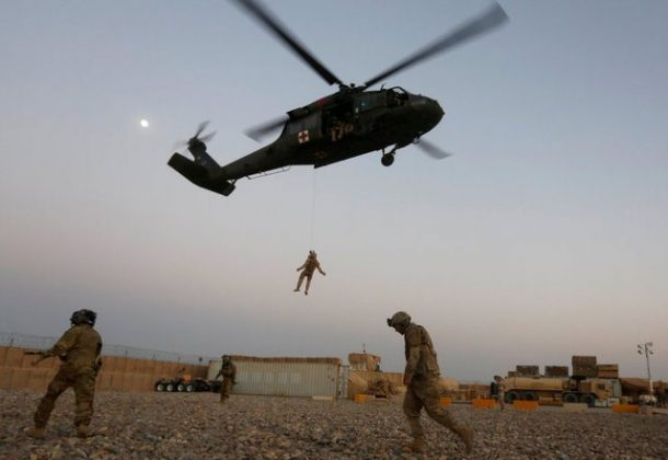 FILE PHOTO: A U.S. Navy Corpsman and U.S. soldier take part in a helicopter Medevac exercise in Helmand province, Afghanistan, July 6, 2017. REUTERS/Omar Sobhani/File Photo