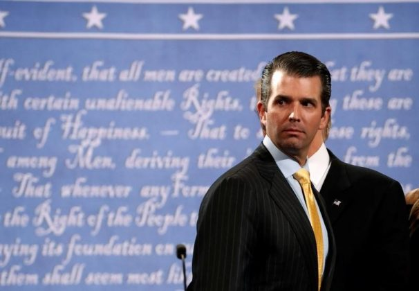 Donald Trump Jr. stands onstage with his father Republican U.S. presidential nominee Donald Trump after Trump's debate against Democratic nominee Hillary Clinton at Hofstra University in Hempstead, New York, U.S. September 26, 2016. REUTERS/Brian Snyder
