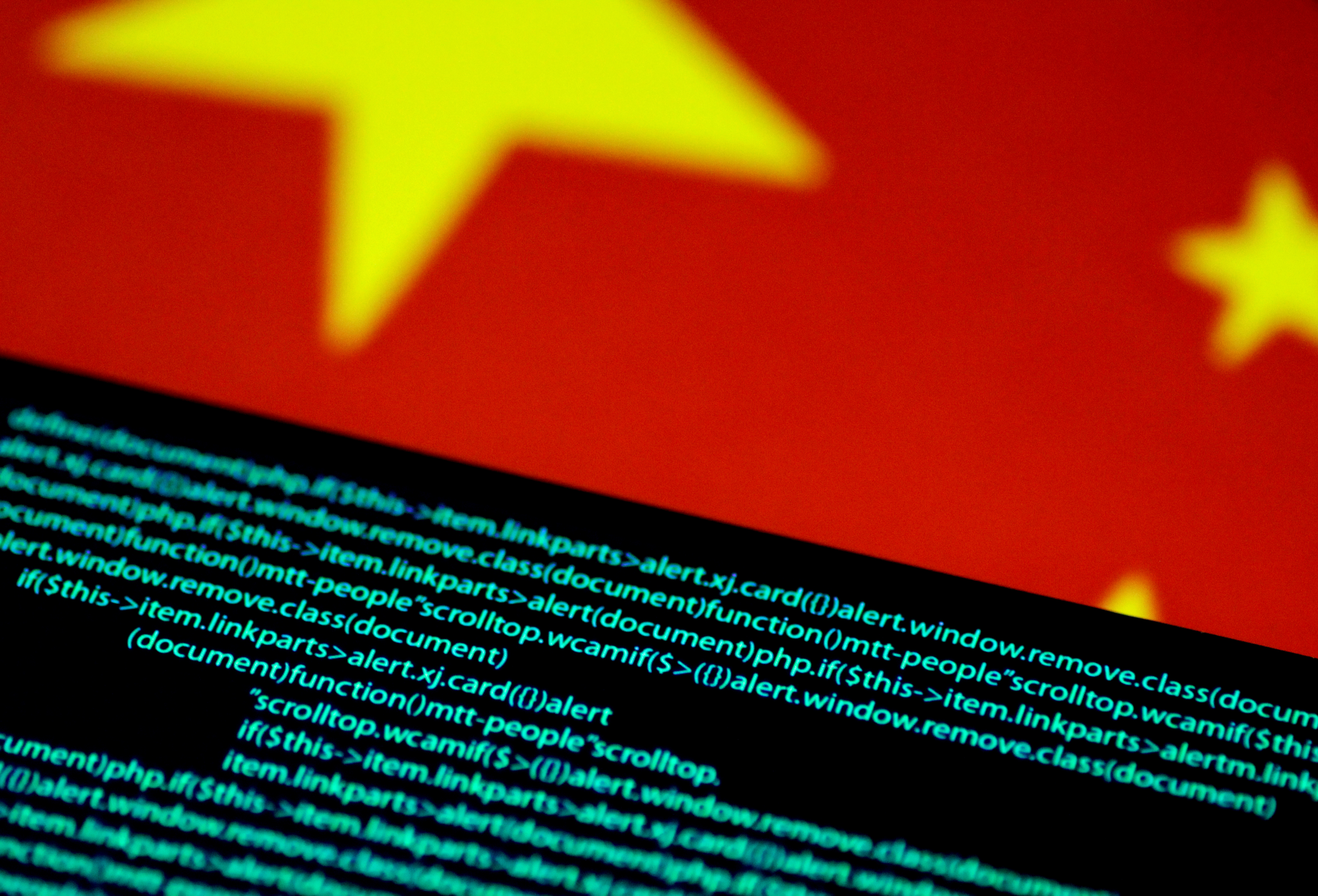 Computer code is seen on a screen above a Chinese flag in this July 12, 2017 illustration photo. REUTERS/Thomas White/Illustration
