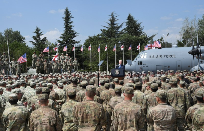 Vice President Mike Pence delivers a speech during a meeting with U.S. troops taking part in NATO led joint military exercises Noble Partner 2017 at the Vaziani military base near Tbilisi, Georgia. REUTERS/Irakli Gedenidze