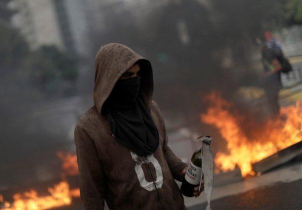 Demonstrators build fire barricades while rallying against Venezuela's President Nicolas Maduro's government in Caracas, Venezuela, August 4,