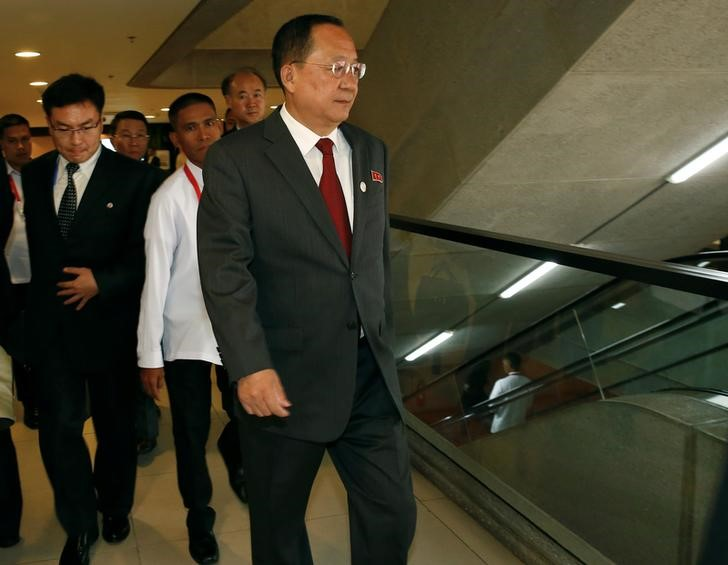 North Korean Foreign Minister Ri Yong-ho (C) walks toward an escalator during ongoing meetings at the Philippine International Convention Center