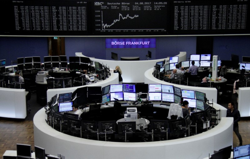 Traders work in front of the German share price index, DAX board, at the stock exchange in Frankfurt, Germany, August 4, 2017.