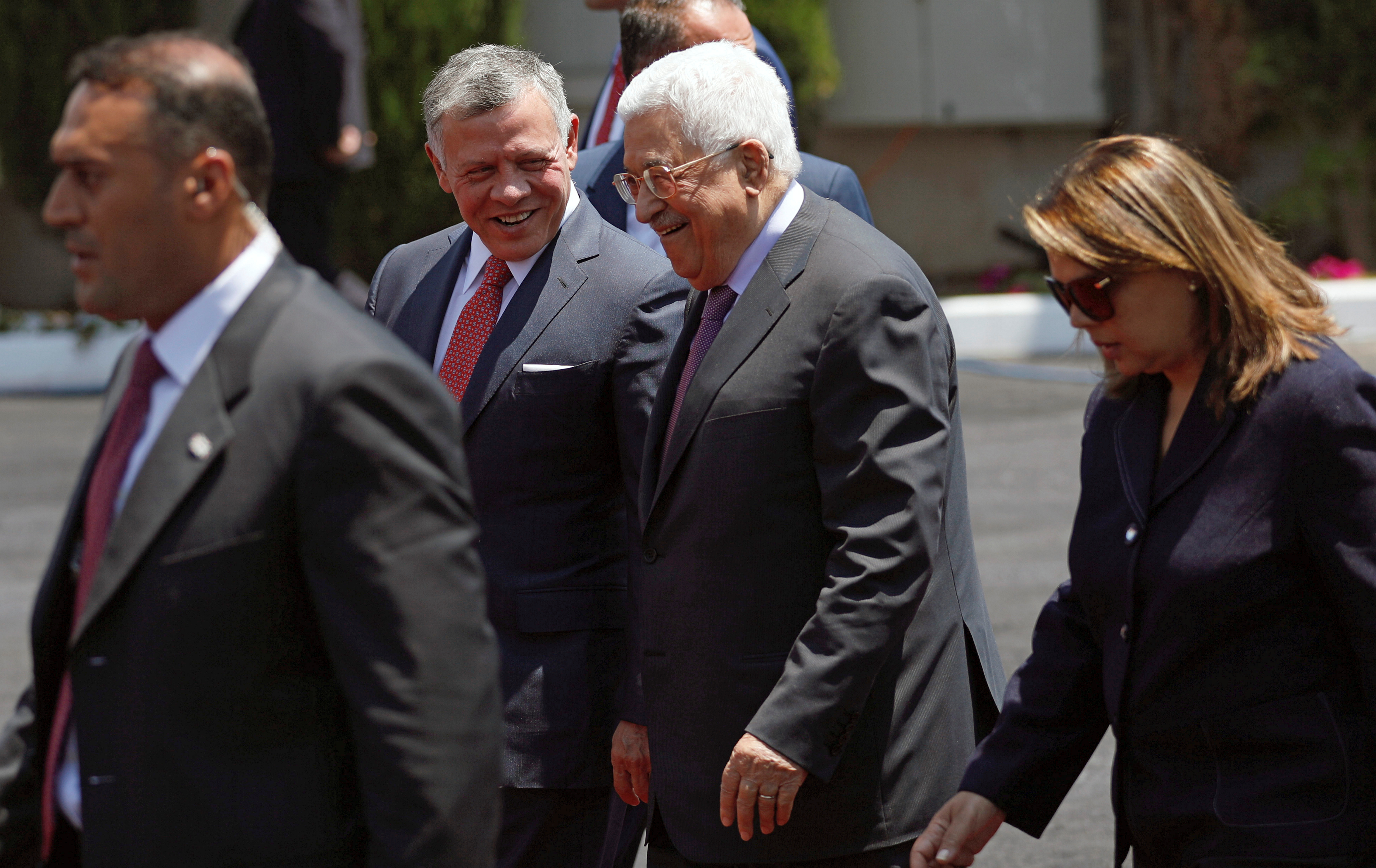 Jordan's King Abdullah II walks with Palestinian President Mahmoud Abbas during a reception ceremony in the West Bank city of Ramallah, August 7, 2017.