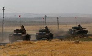 : Turkish army tanks drive towards to the border in Karkamis on the Turkish-Syrian border in the southeastern Gaziantep province, Turkey, August 25,