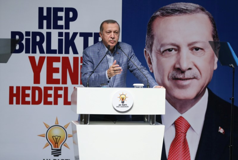 """Turkish President Tayyip Erdogan speaks during a meeting of his ruling AK Party in Rize, Turkey, August 7, 2017. Picture taken August 7, 2017. The party banner in the background reads that: """"Together with new targets"""". Murat Cetinmuhurdar/Presidential Palace/Handout via REUTERS"""