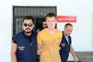 Russian national Renat Bakiev, a suspected Islamic State militant who allegedly planned to use a drone to bring down a U.S. plane at the Incirlik air base, is escorted by police officers as he arrives to a hospital for a medical check in the city of Adana, Turkey, August 10, 2017. Dogan News Agency via REUTERS