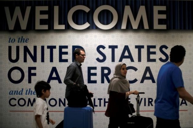 FILE PHOTO - International passengers arrive at Washington Dulles International Airport after the U.S. Supreme Court granted parts of the Trump administration's emergency request to put its travel ban into effect later in the week pending further judicial review, in Dulles, Virginia, U.S., June 26, 2017. REUTERS/James Lawler Duggan