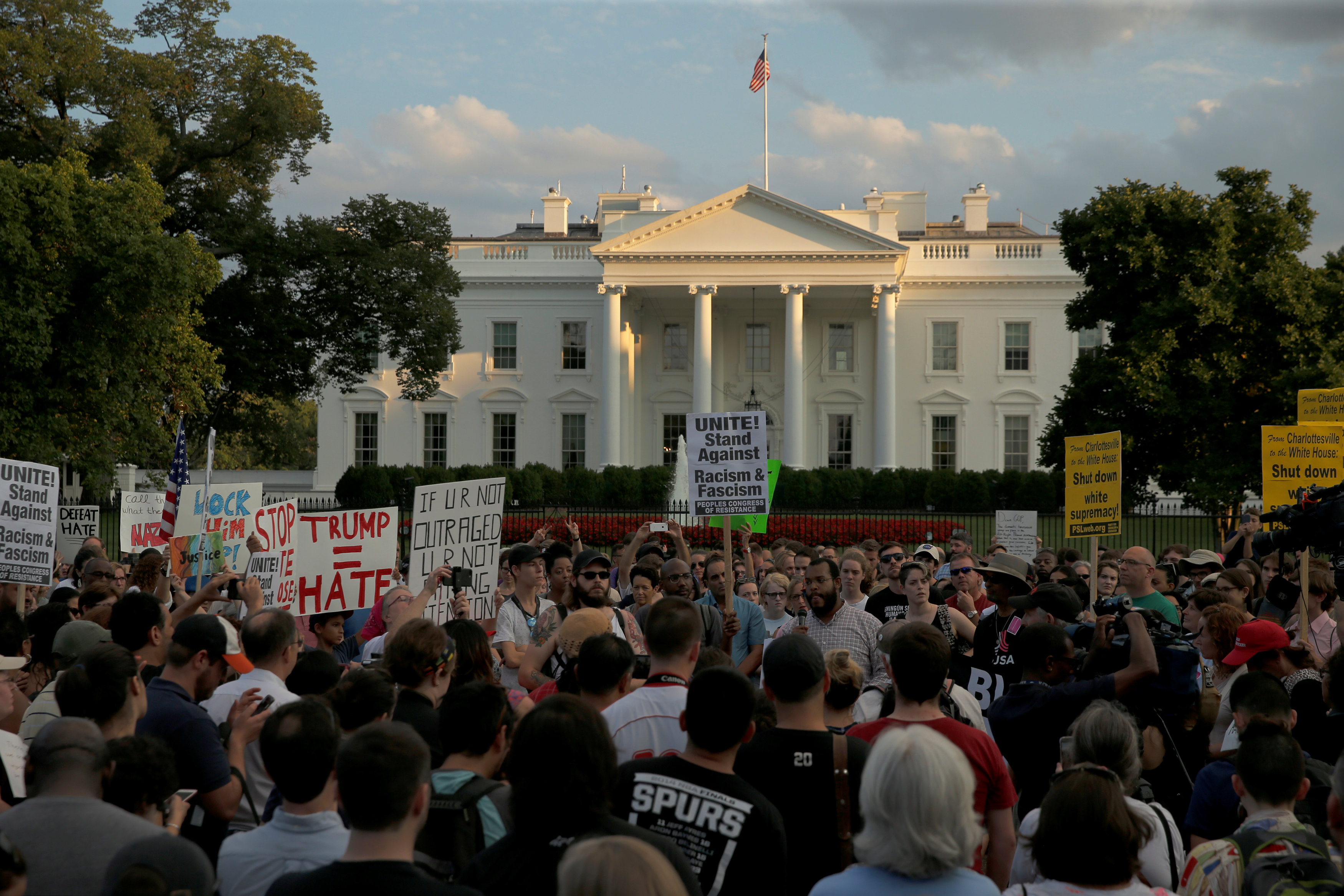 """People gather for a vigil in response to the death of a counter-demonstrator at the """"Unite the Right"""" rally in Charlottesville, outside the White House in Washington,"""