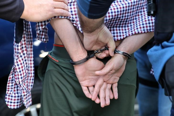 U.S. Immigration and Customs Enforcement (ICE) agents arrest an immigrant in San Clemente, California,