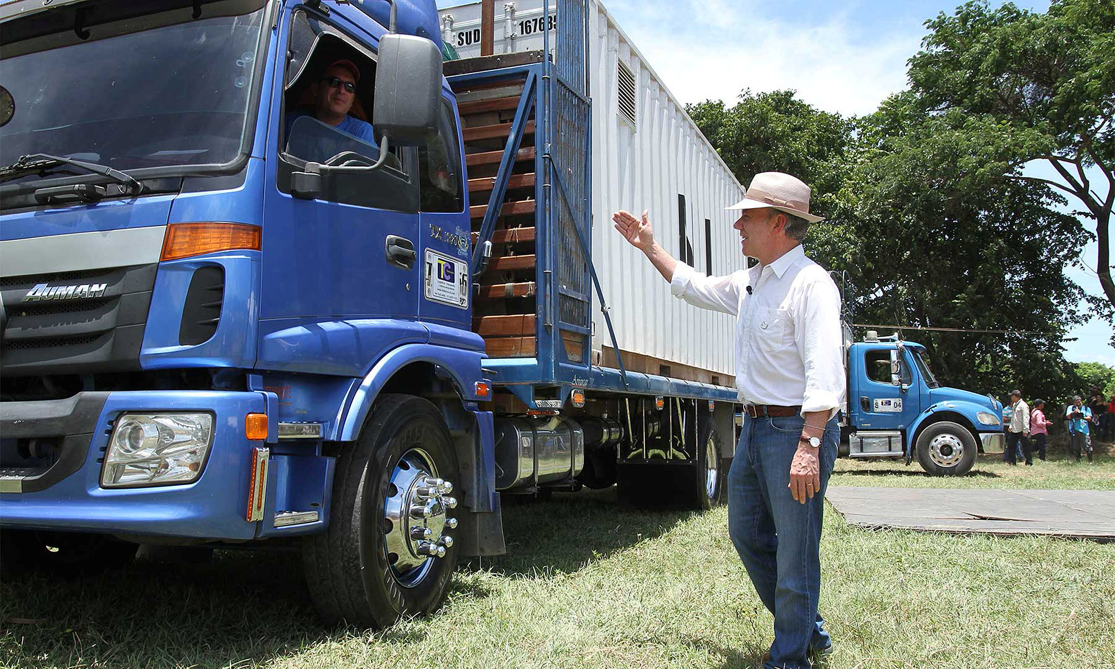 Colombia's President Juan Manuel Santos greets a driver carrying the last container with surrendered weapons delivered by FARC rebels to a UN observer in La Guajira, Colombia August 15, 2017. Colombian Presidency/Handout via REUTERS