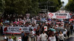 Thousands of Mexicans march to scrap NAFTA, as government fights to save it