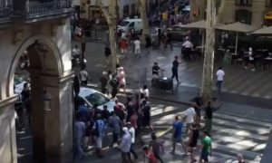 Van crashes into crowds in Barcelona, media say two killed