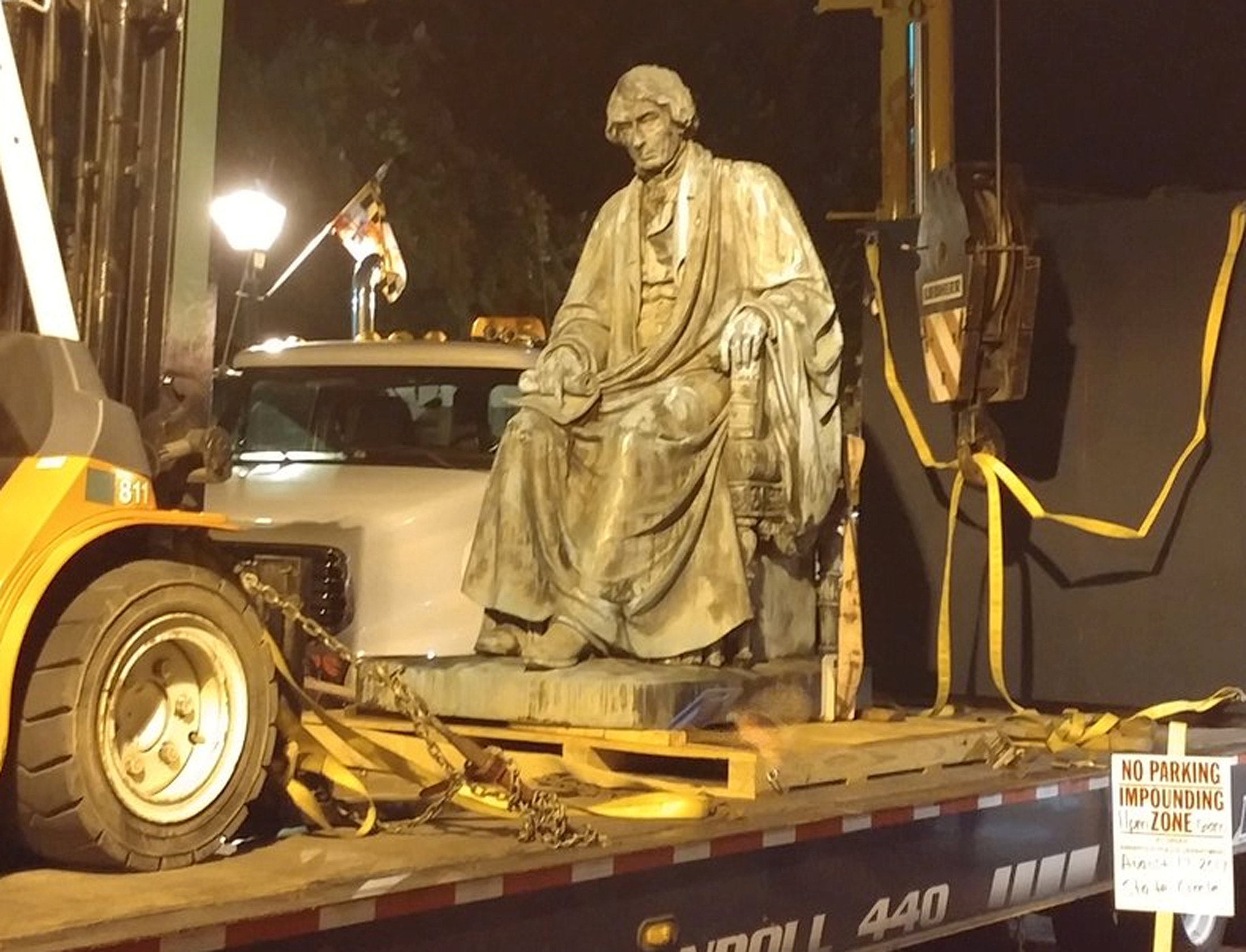 The statue of former Supreme Court Chief Justice Roger B. Taney is seen on a flatbed trailer after it was removed from outside the Maryland State House in Annapolis, Maryland, U.S. early August 18, 2017 in this image obtained from social media. Courtesy @BeeprB/Handout via REUTERS
