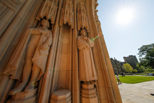 The empty plinth where a statue of Confederate commander General Robert E. Lee once stood is flanked by statues of Thomas Jefferson and the poet Sidney Lanier at the entrance to Duke University's Duke Chapel after officials removed the controversial statue early Saturday morning in Durham, North Carolina, U.S., August 19, 2017. REUTERS/Jason Miczek