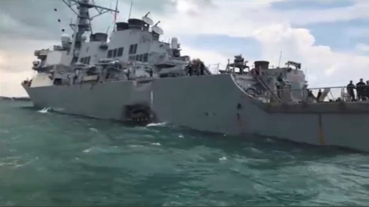 Damage is seen on the U.S. Navy guided-missile destroyer USS John S. McCain after a collision, in Singapore waters in this still frame taken from video August 21, 2017.
