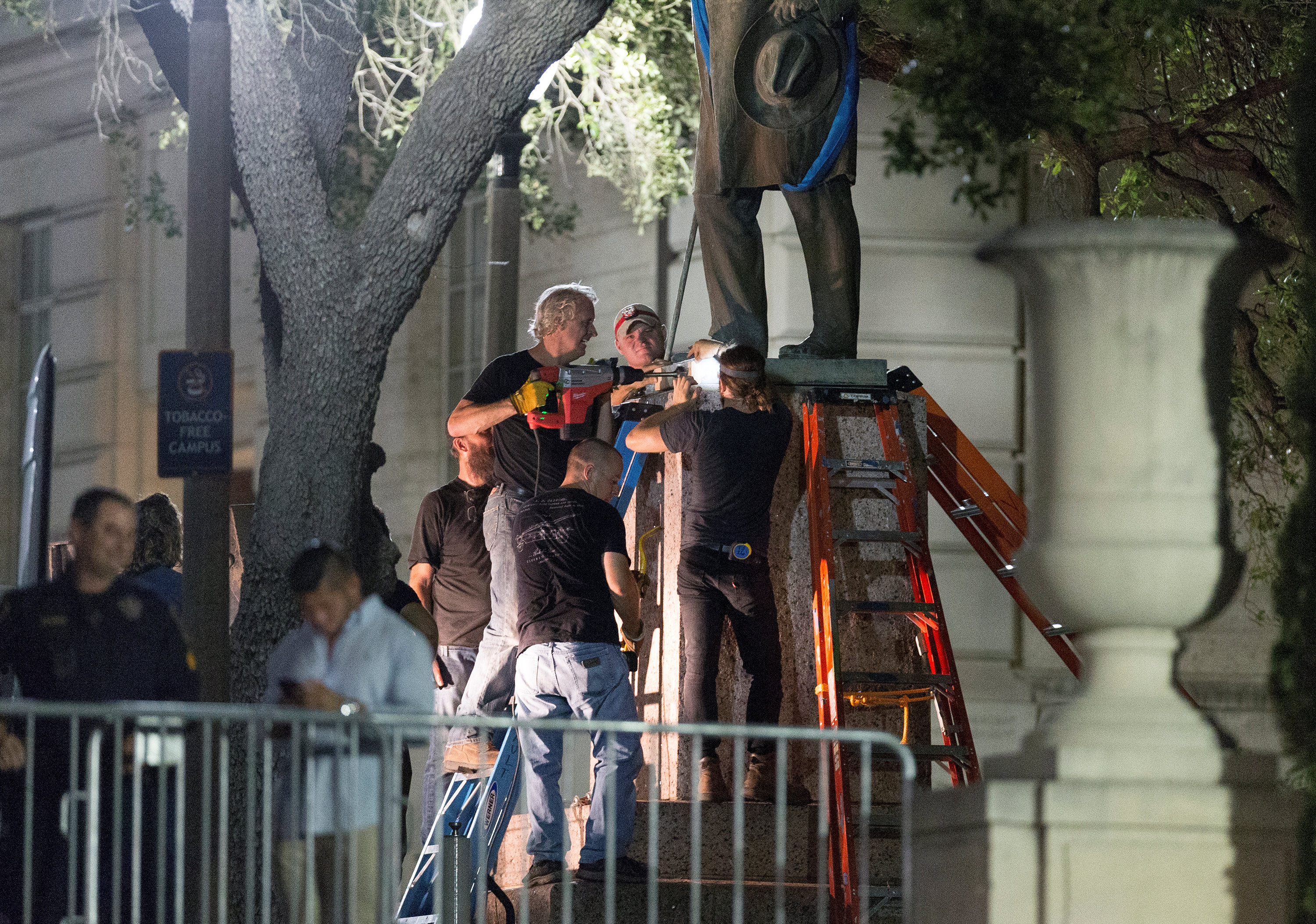Workers remove Confederate Postmaster General John Reagan statue from the south mall of the University of Texas in Austin, Texas, U.S., August 21, 2017.