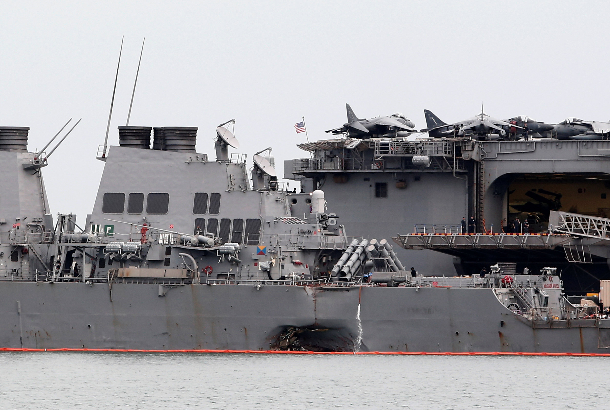 The damaged USS John McCain is docked next to USS America at Changi Naval Base in Singapore August 22, 2017. REUTERS/Calvin Wong