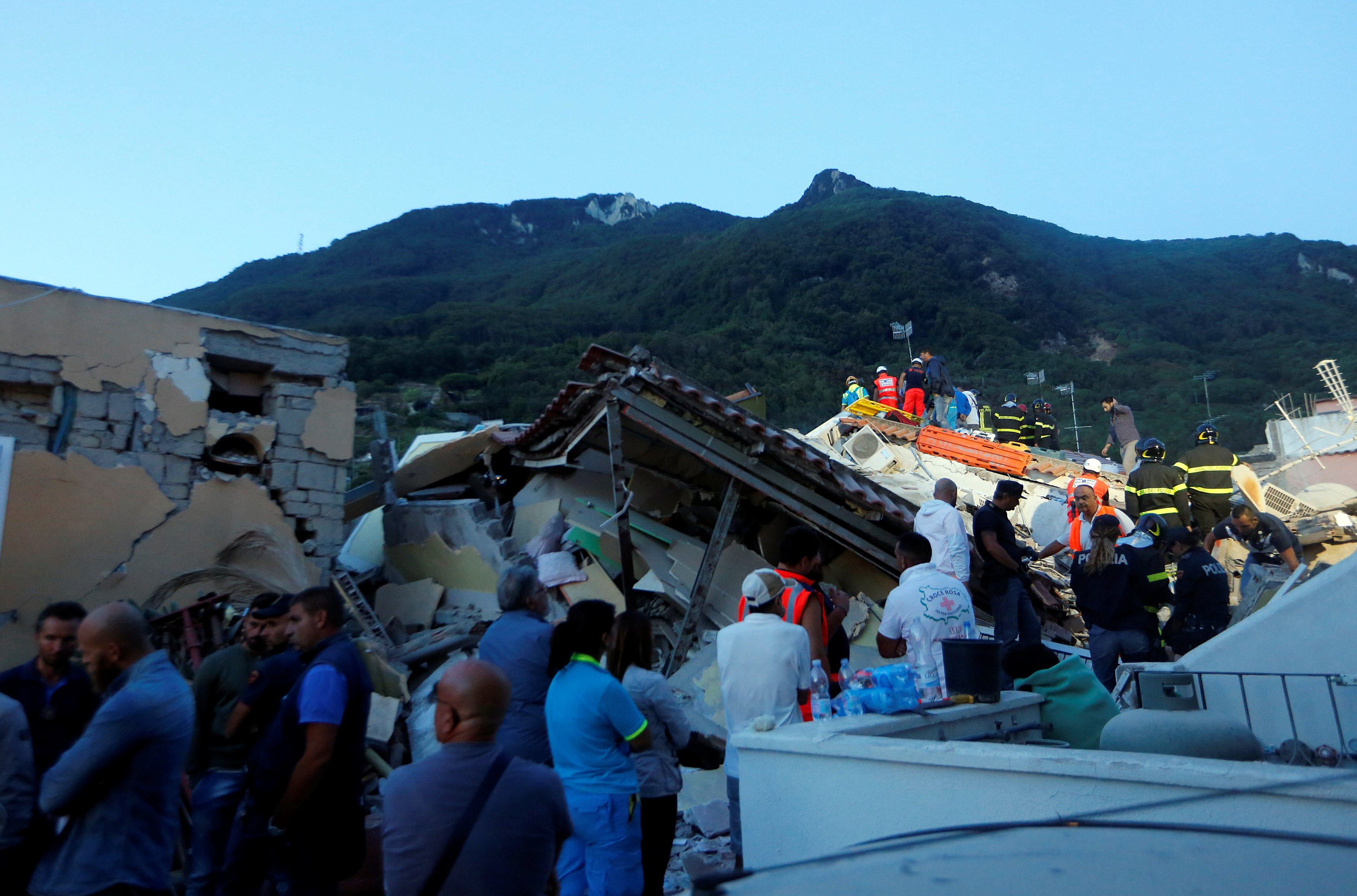 Rescue workers check a collapsed house after an earthquake hit the island of Ischia, off the coast of Naples, Italy August 22, 2017. REUTERS/Ciro De Luca