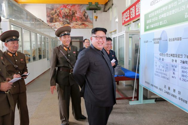 North Korean leader Kim Jong-Un smiles during a visit to the Chemical Material Institute of the Academy of Defense Science in this undated photo released by North Korea's Korean Central News Agency (KCNA) in Pyongyang on August 23, 2017. KCNA/via REUTERS