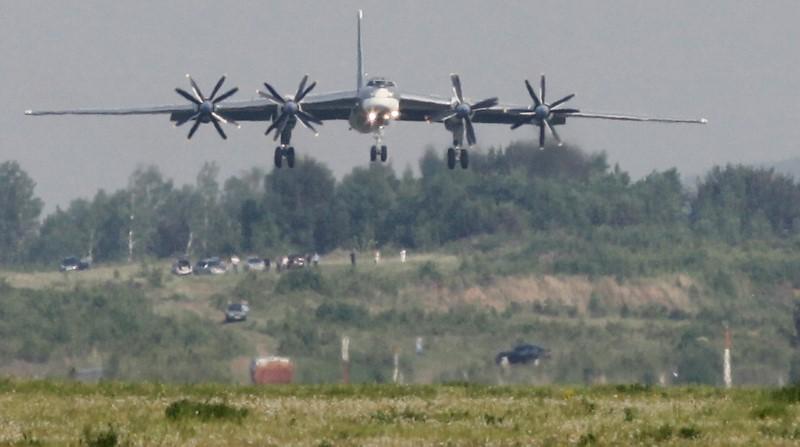 A Tupolev Tu-95MS strategic bomber, the carrier of nuclear rockets, lands at the Yemelyanovo airport near Russia's Siberian city of Krasnoyarsk, June 8, 2011. REUTERS/Ilya Naymushin