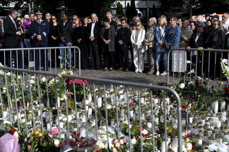 FILE PHOTO: People attend a moment of silence to commemorate the victims of Friday's stabbings at the Turku Market Square in Turku, Finland August 20, 2017. Lehtikuva/Vesa Moilanen via REUTERS