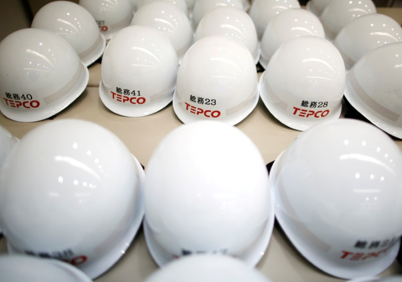 FILE PHOTO: Logo of the Tokyo Electric Power Co Holdings (TEPCO) is seen on helmets at TEPCO's South Yokohama Thermal Power Station in Yokohama, Japan July 18, 2017. REUTERS/Issei Kato/File Photo