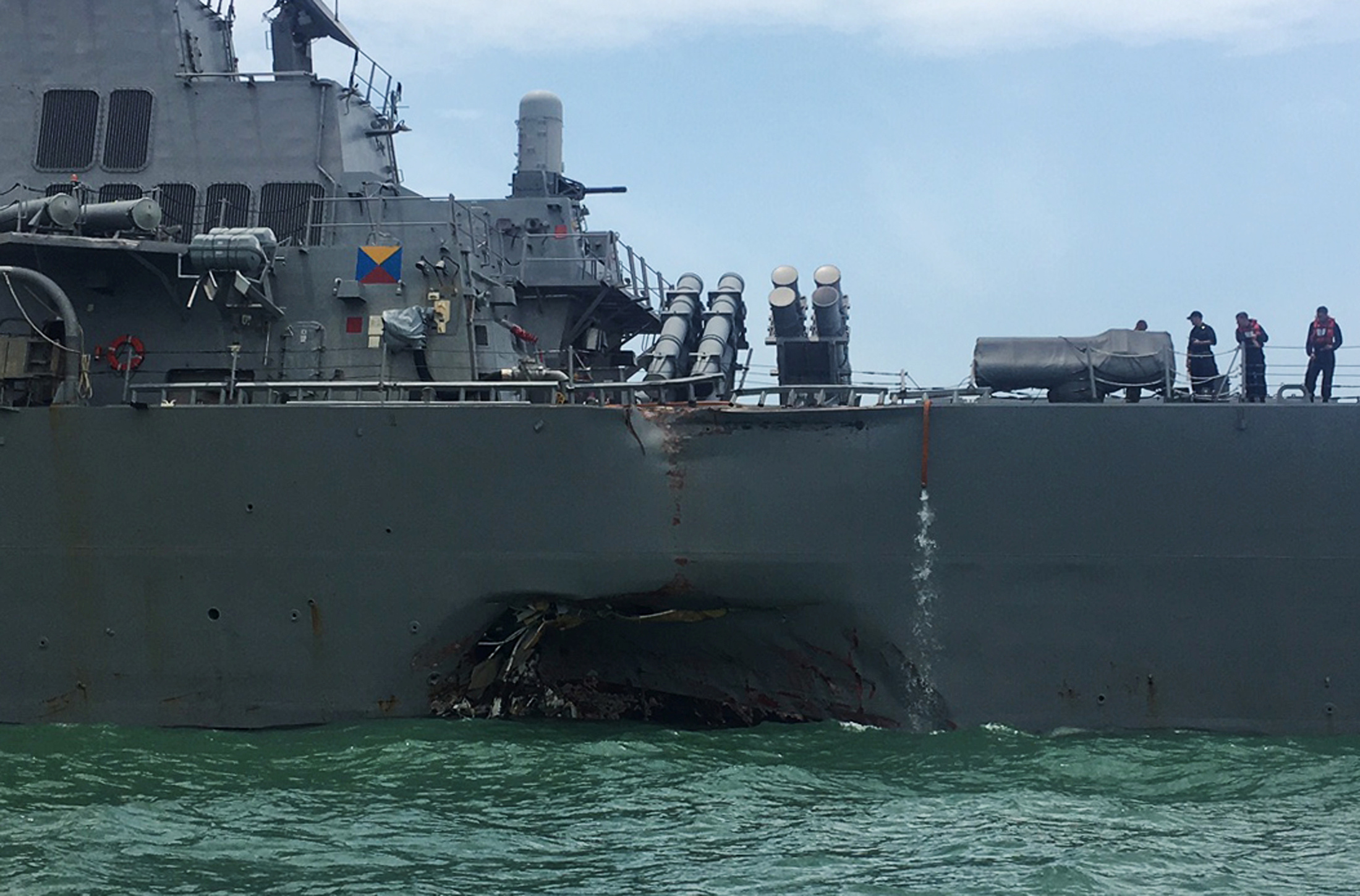 The U.S. Navy guided-missile destroyer USS John S. McCain is seen after a collision. REUTERS/Ahmad Masood