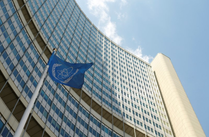 FILE PHOTO: The flag of the International Atomic Energy Agency (IAEA) flies in front of IAEA's headquarters during a board of governors meeting in Vienna, Austria June 12, 2017. REUTERS/Heinz-Peter Bader