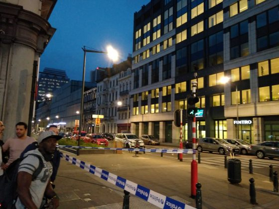 People walk next to the scene where a man attacked two soldiers with a knife in Brussels, Belgium August 25, 2017 in this picture obtained from social media. Picture taken August 25, 2017. Thomas Da Silva Rosa /via REUTERS