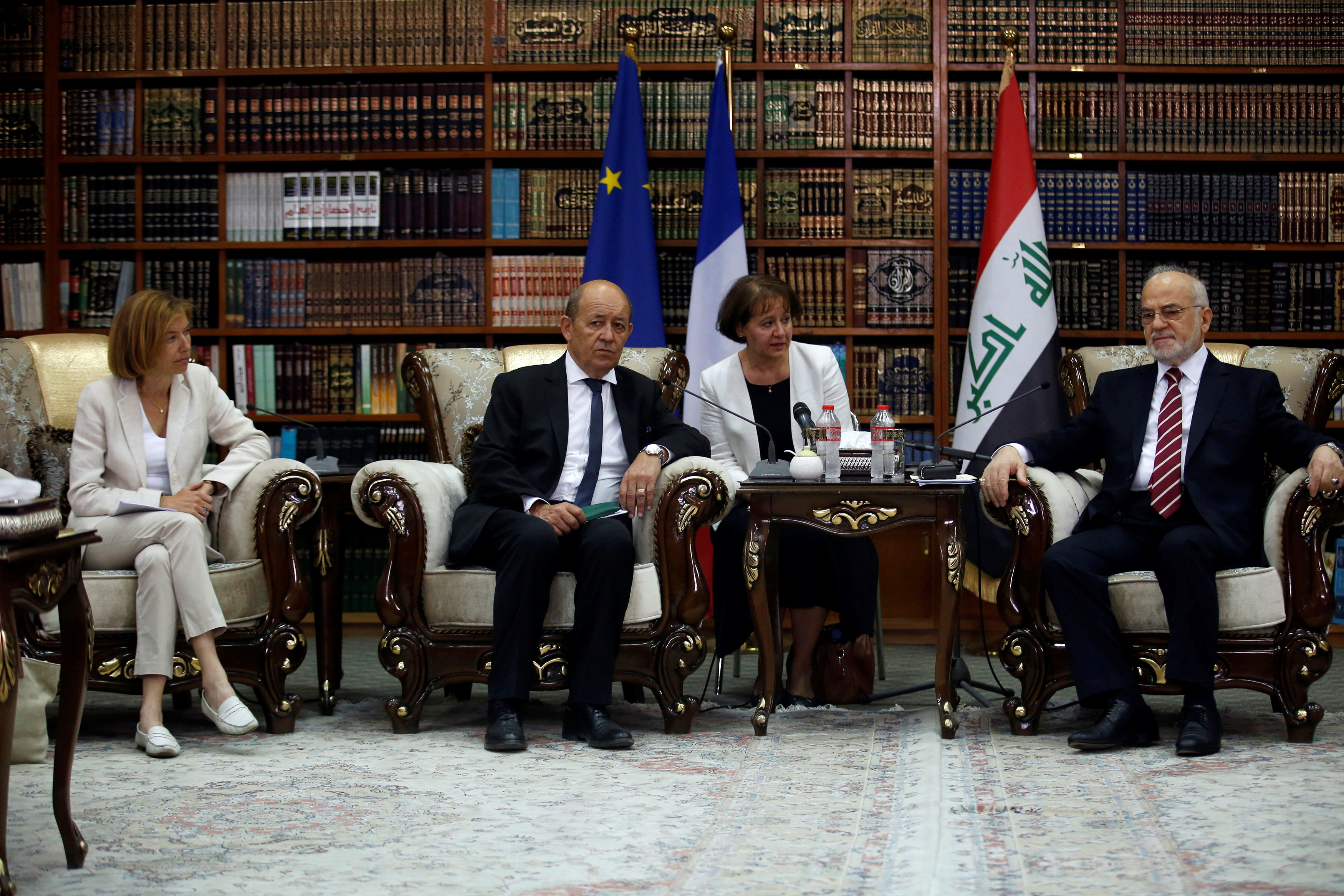 French Foreign Minister Jean-Yves Le Drian (C) and French Defence Minister Florence Parly (L) meet with Iraqi Foreign Minister Ibrahim al-Jaafari in Baghdad, Iraq August 26, 2017. REUTERS/Khalid al Mousily