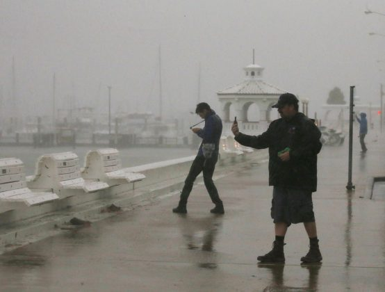 A storm chaser films himself on a camera phone as Hurricane Harvey approaches, on the boardwalk in Corpus Christi, Texas. REUTERS/Adrees Latif