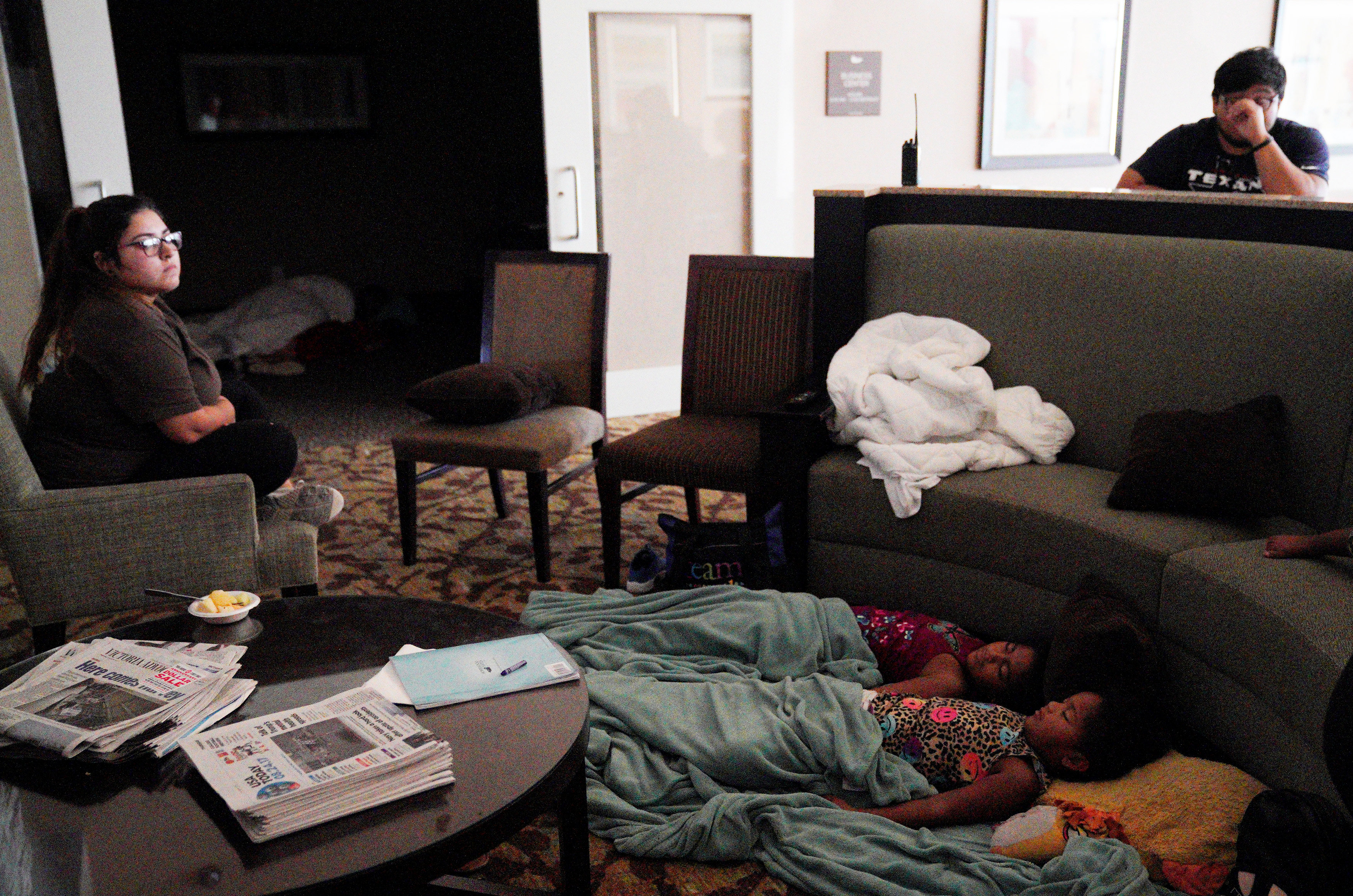 Children sleep in a hotel lobby waiting out Hurricane Harvey in Victoria, Texas, August 26, 2017. REUTERS/Rick Wilking