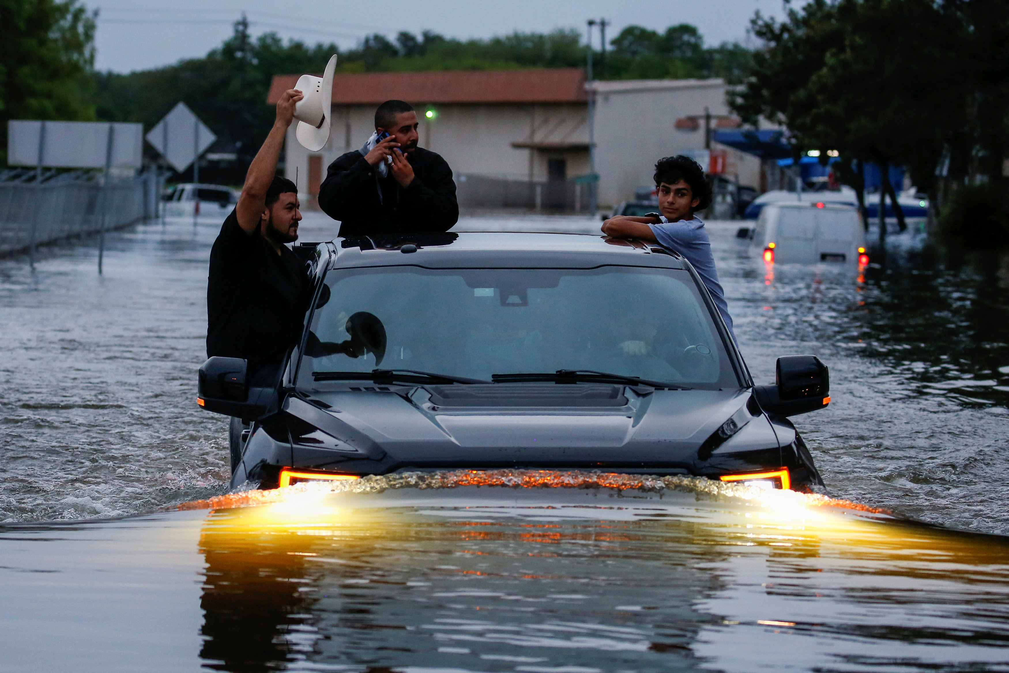 Residents use a truck to navigate through flood waters from Tropical Storm Harvey in Houston, Texas, U.S. August 27, 2017.